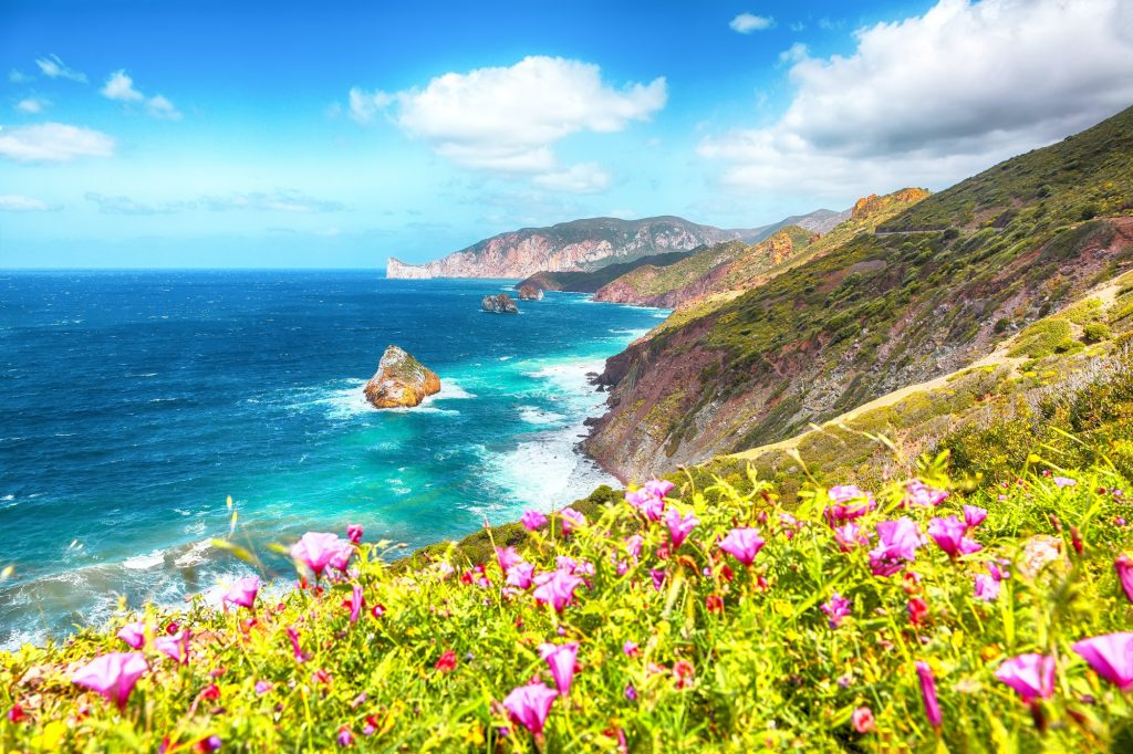 Amazing spring view of Nebida and Masua coast and Pan Di Zucchero on background.