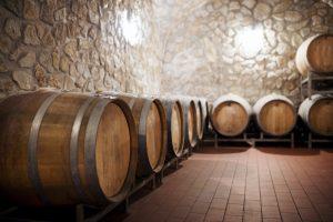 Barrels in cellar, wine making concept. Copy space