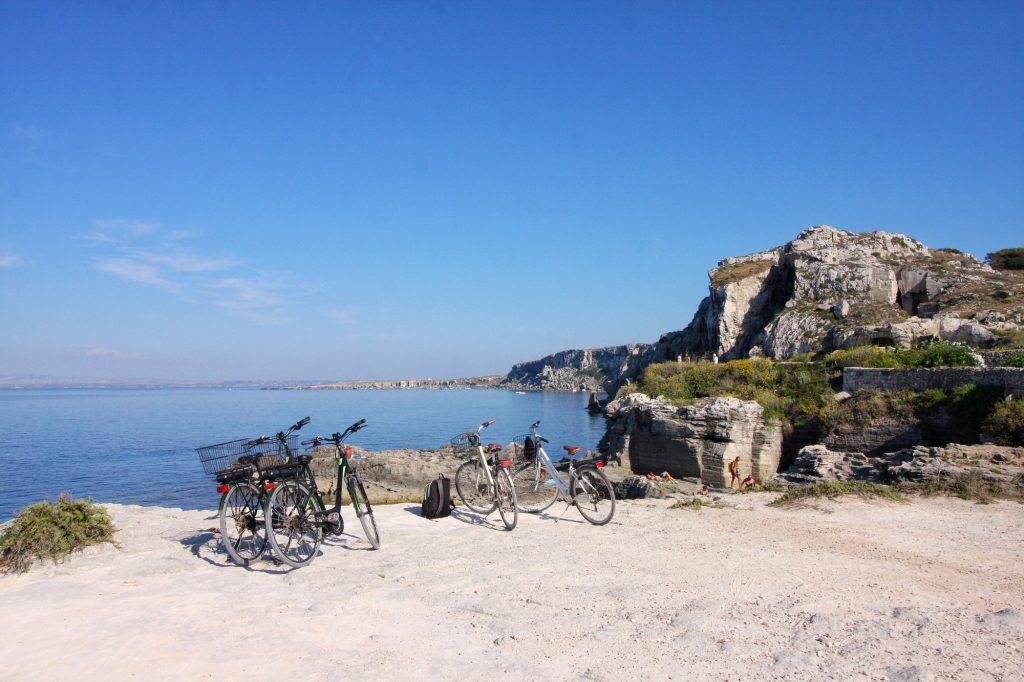 Bicycles on the beach near a stunning beach in favignana Sicily Italy