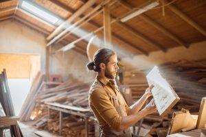 Carpenter at the wood storage