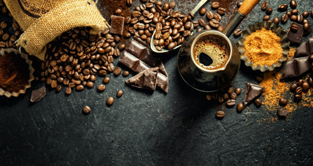 Coffee beans with props for making coffee