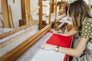 Designer weaving her own fabric