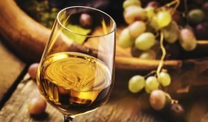 Dry white wine in glass, old-fashioned still life, banner