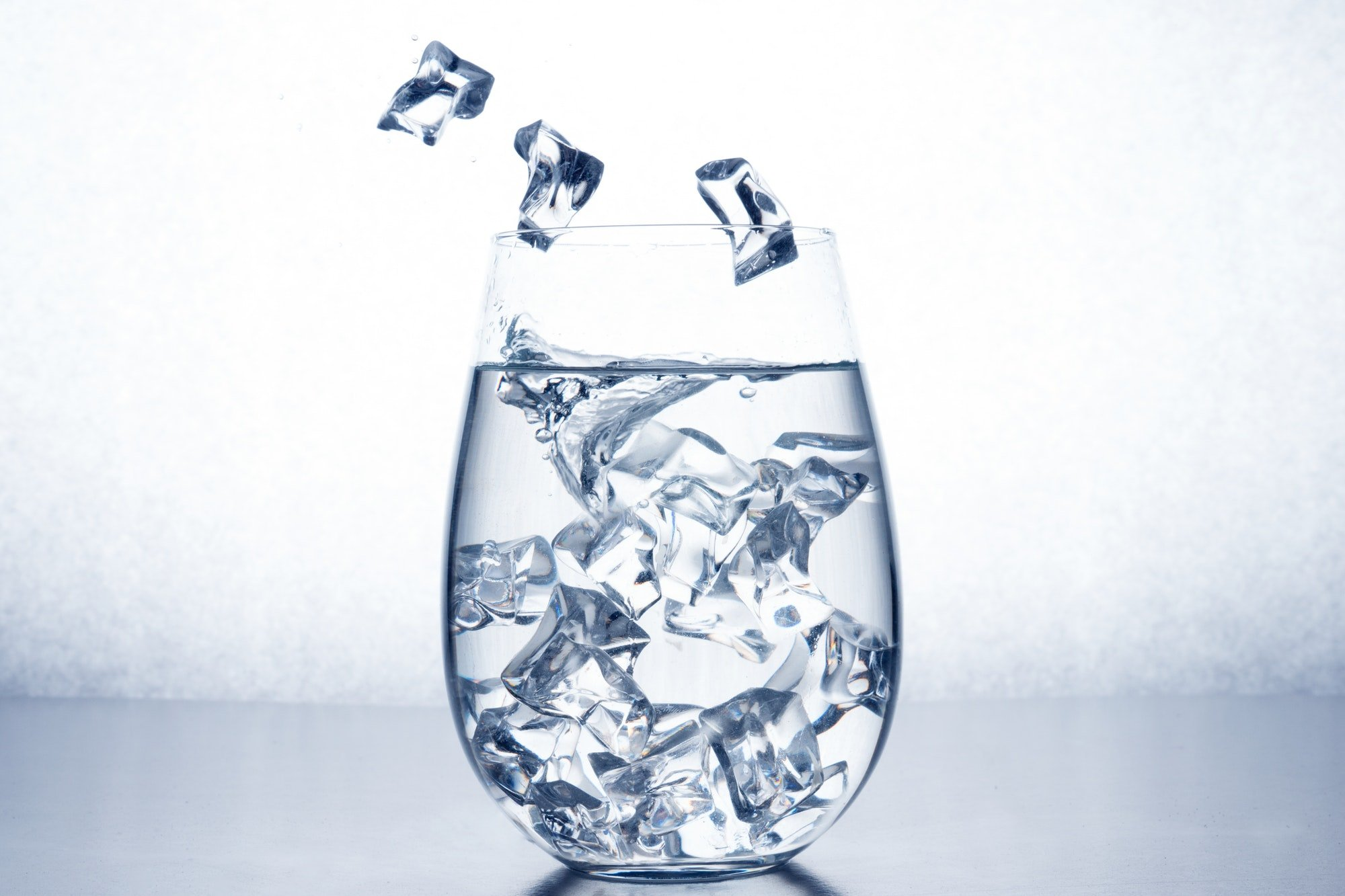 Glass of water with ice cubes.