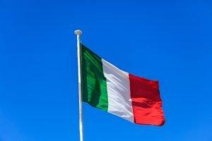 Italy flag. Italian flag on a pole waving on blue sky background