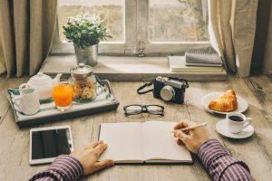 Man writing a journal