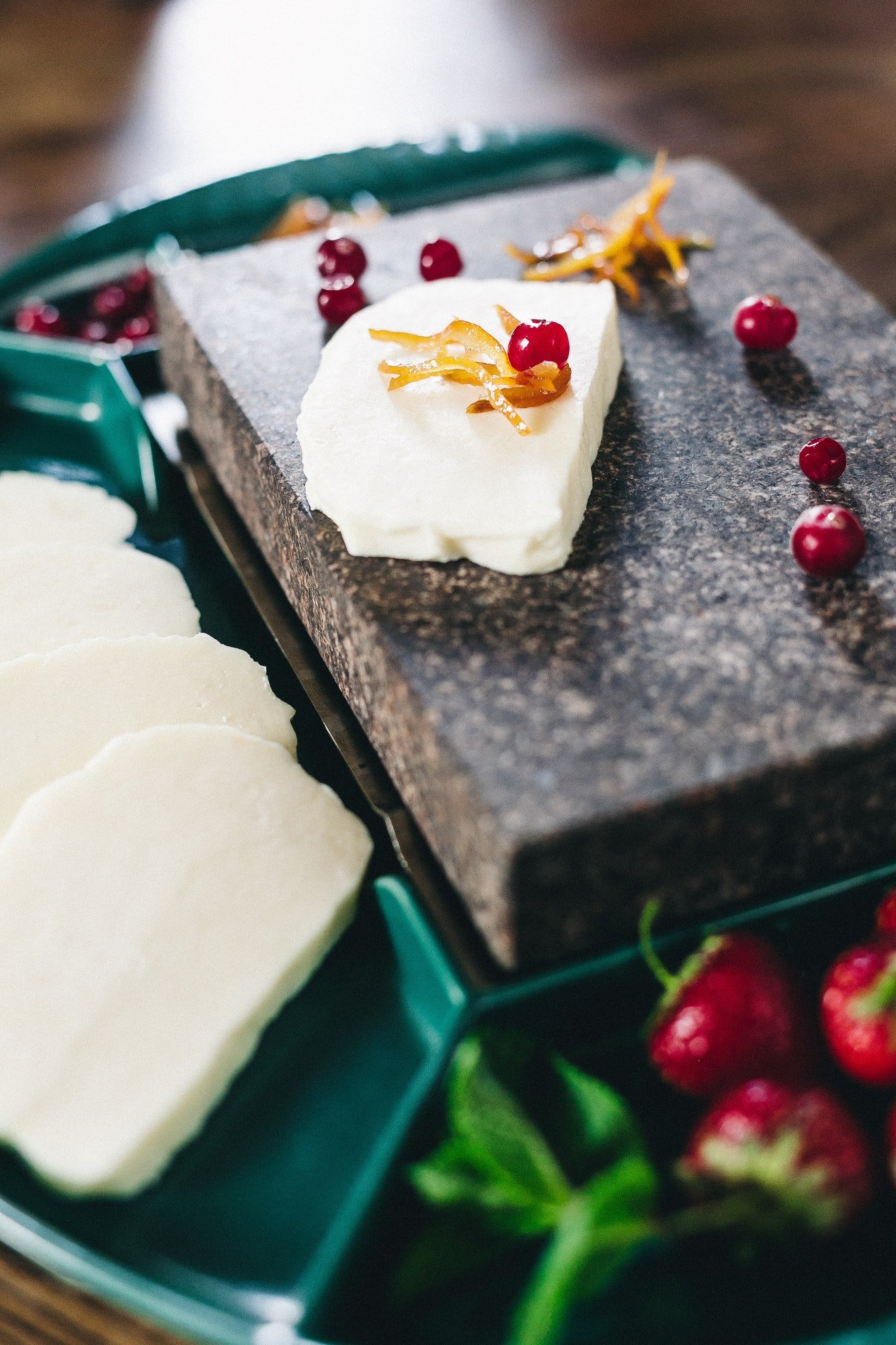 Mozzarella cheese in wooden bowl on white rustic table top view. Soft italian cheese