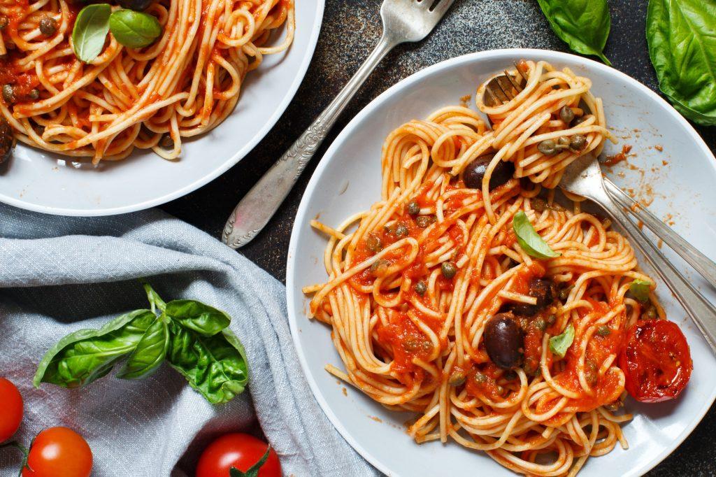 Pasta alla puttanesca - Spaghetti with tomato sauce olives and capers