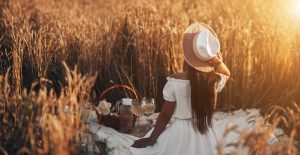 Picnic on a summer sunny day in a wheat field