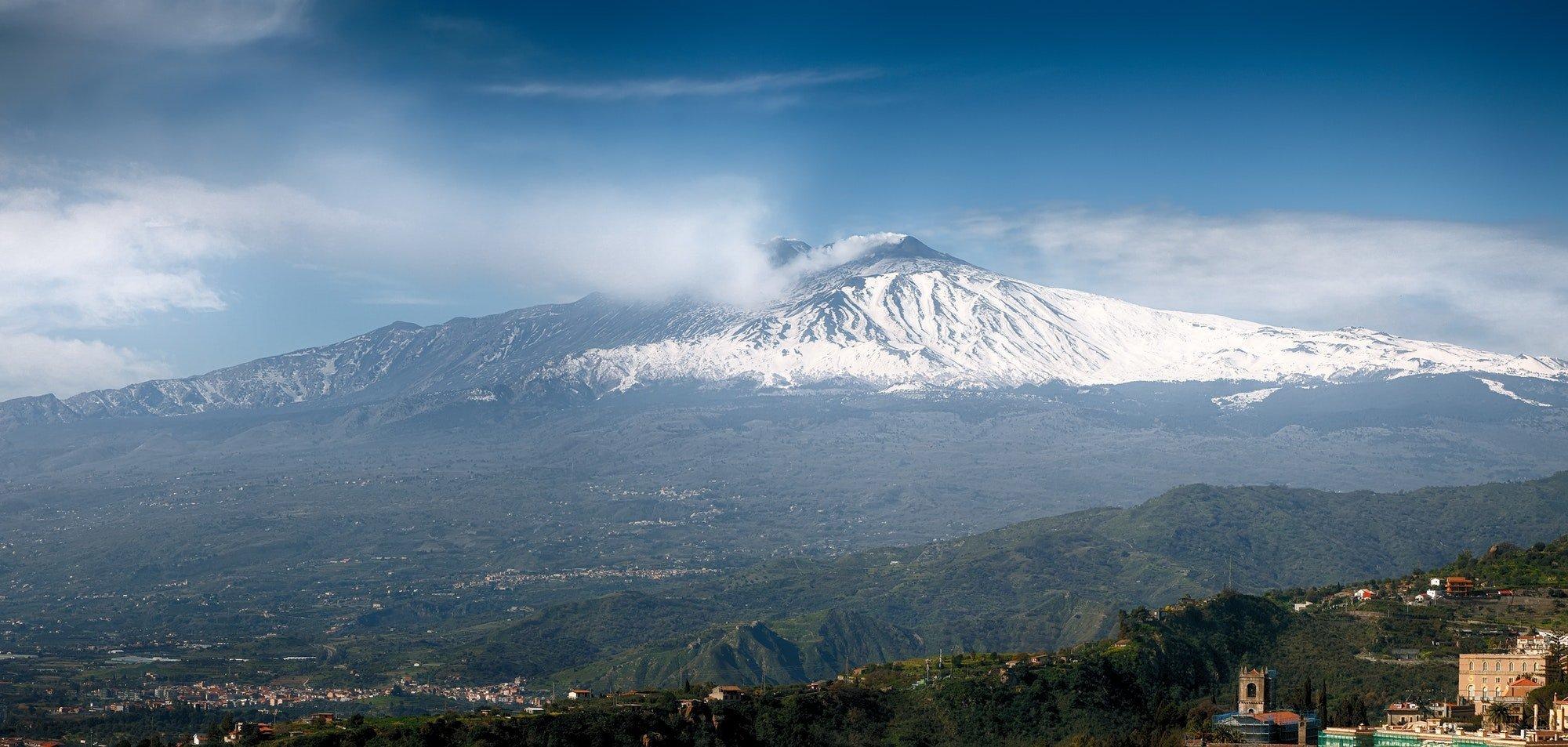 Smoking Mount Etna Volcano as seen from Taormina
