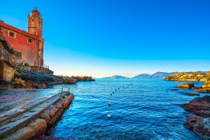 Tellaro sea village church and buoys. Cinque terre, Ligury Italy