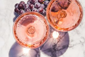 Two crystal stemmed glasses with rose wine