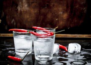 Vodka shots with chili pepper.