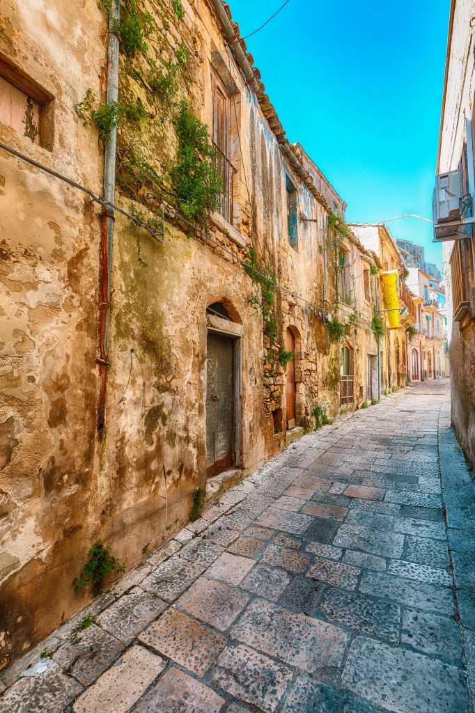 Walking around the old streets of baroque town Ragusa Ibla in Sicily