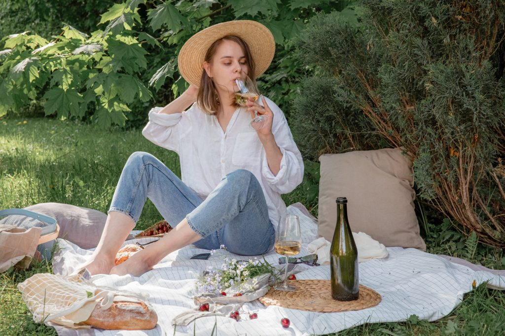 Woman on a picnic drinking wine