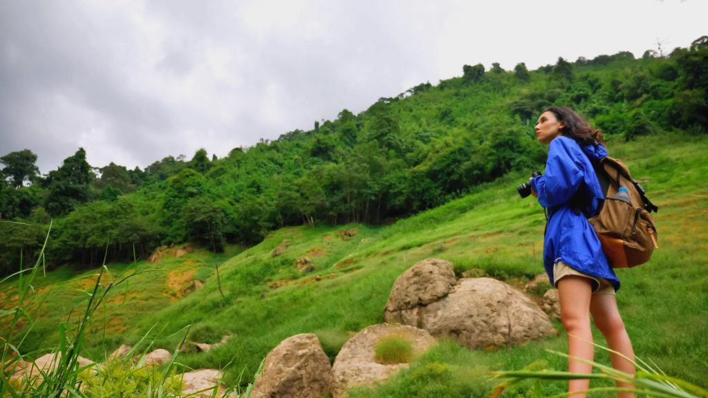Young woman backpacker enjoy the view at mountain