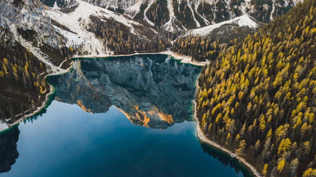 Amazing autumn landscape of Lago di Braies Lake in italian Dolomites mountains in