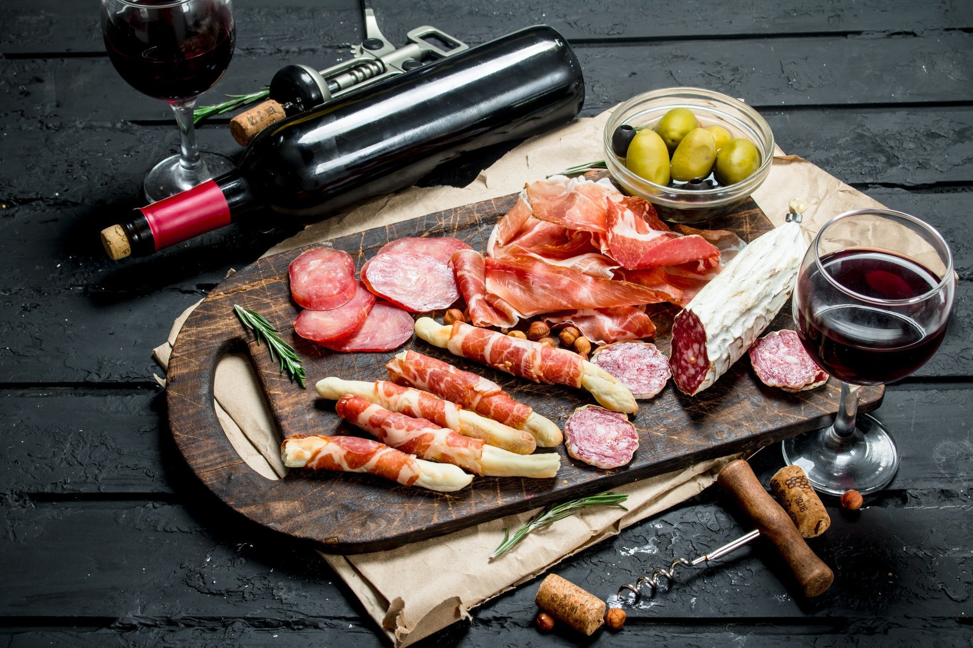 Antipasto background.Traditional Italian appetizers with red wine.