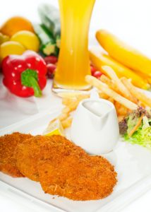 classic Milanese veal cutlets and vegetables
