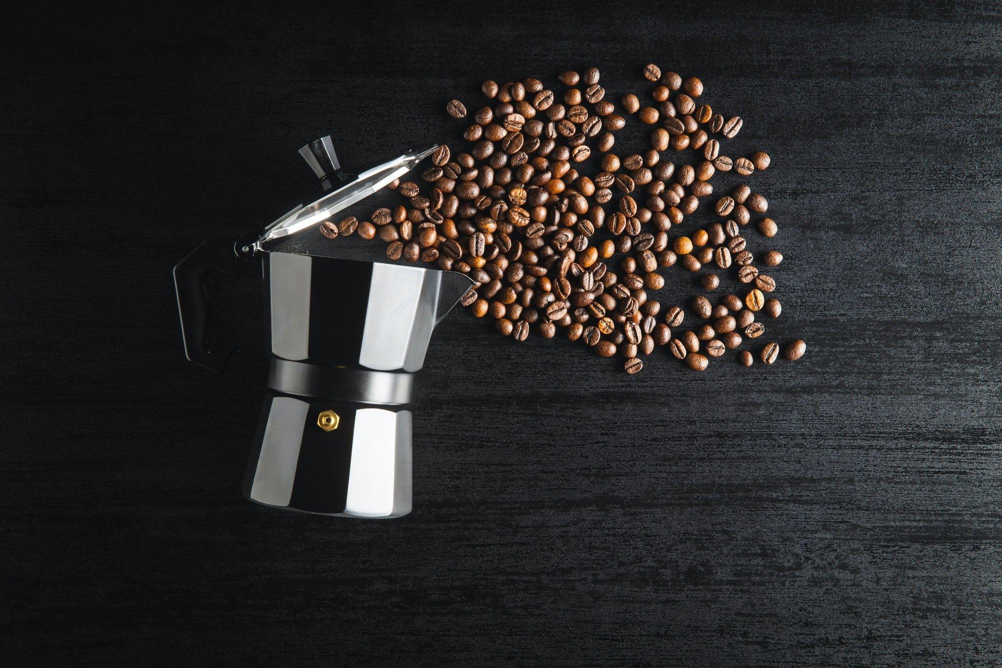 Coffee beans and bialetti coffee maker. Moka pot