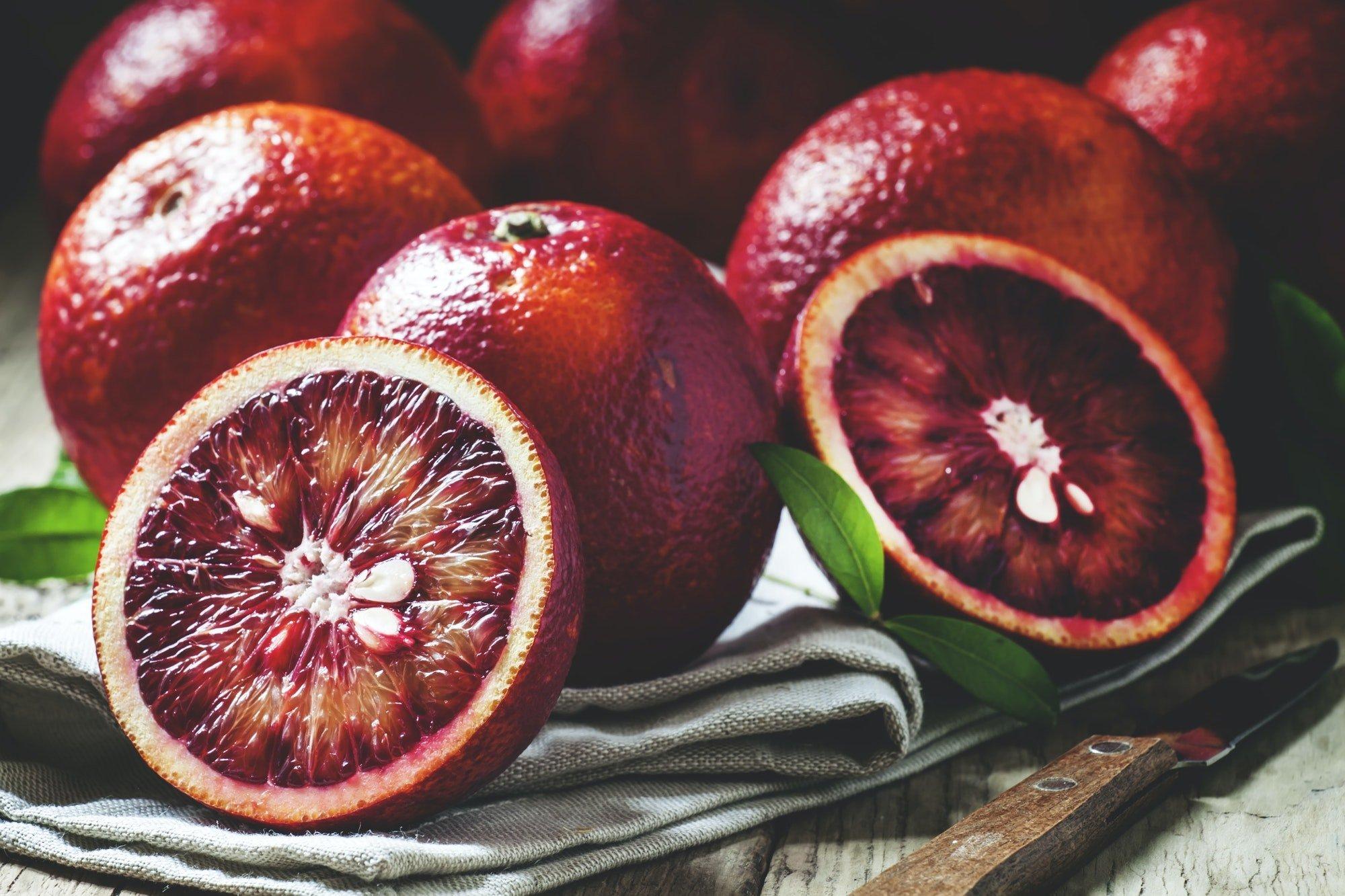 Halved red Sicilian oranges