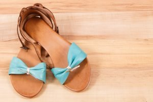 Leather sandals for woman, footwear for holiday concept, copy space for text