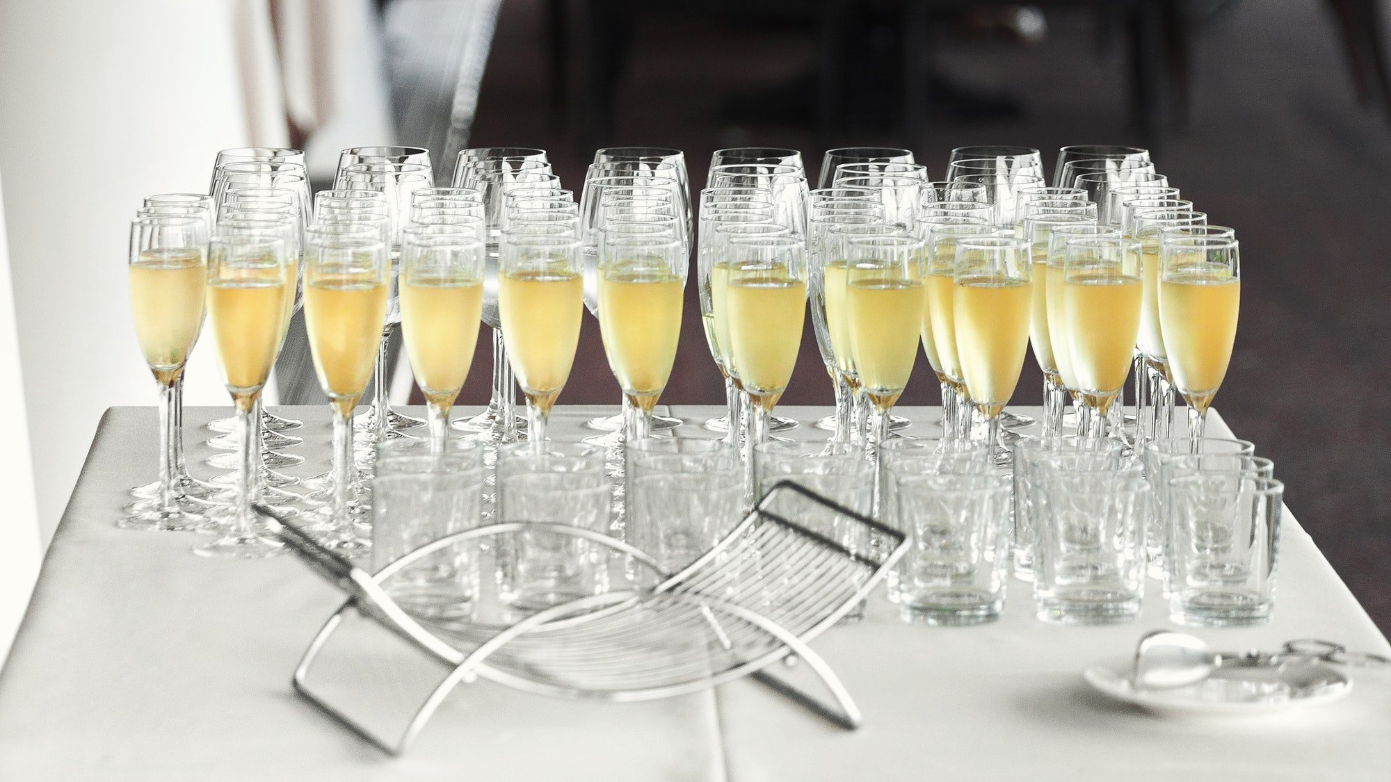 Lots of wine glasses with cool delicious champagne
