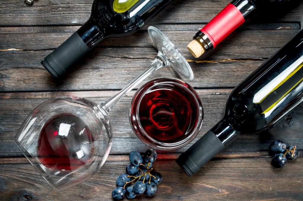 Wine background. Red wine with grapes.
