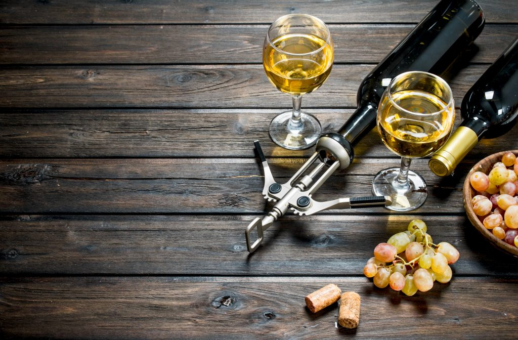 Wine background. White wine with grapes.