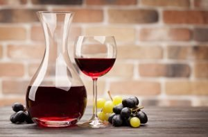 Wine decanter and glass of red wine