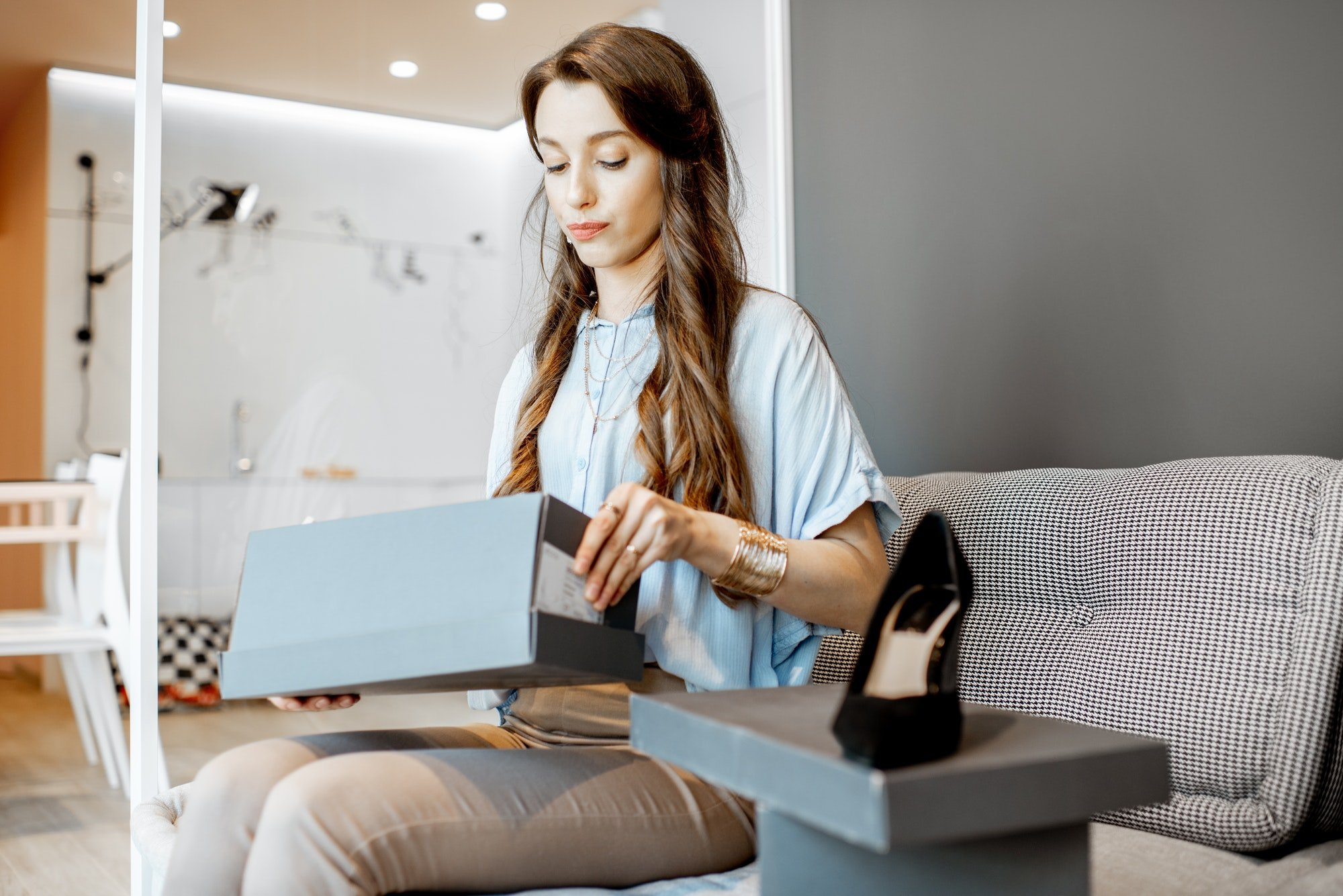 Woman with online puchases at home