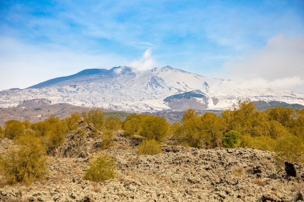 Etna Volcano with smoke in winter, volcano landscape from Catania, Sicily island, Italy