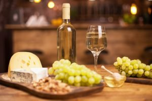 Food festival with different cheeses and white wine in a vintage restaurant